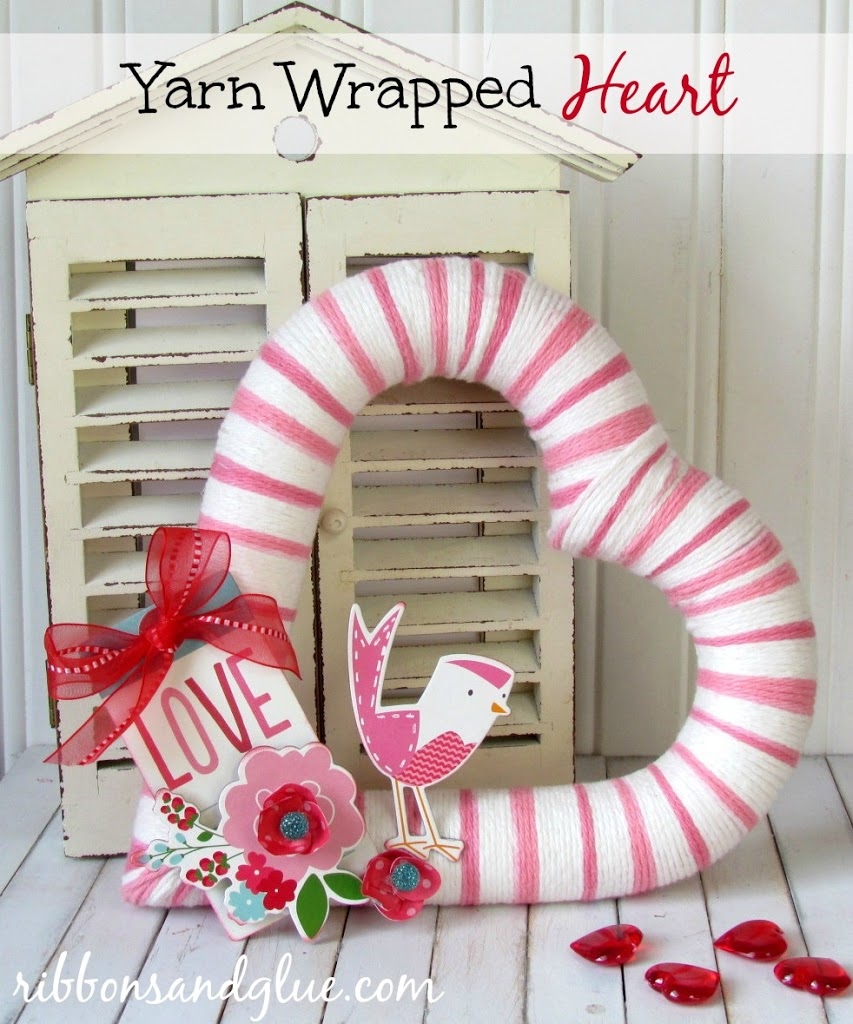 Yarn Wrapped Heart. Foam heart wrapped in yarn and embellished with scrapbooking embellishments. Super Cute Valentine's Day craft
