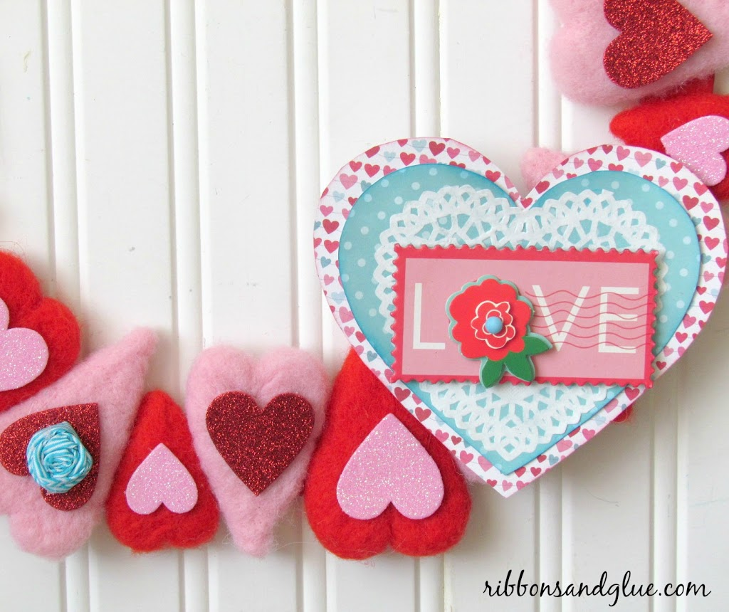 Easy Heart Wreath Makeover with glitter heart table scatter, scrapbooking paper and pretty ribbon